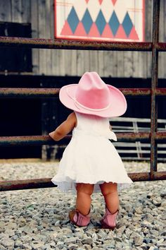sweet in her pink hat and boots