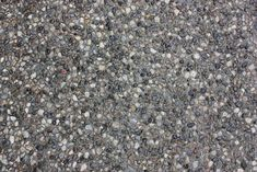 Exposed Aggregate. No Colour Added. LOCATION: Driveway, in front of garage ???