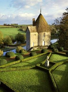 En Bourgogne, France. Once upon a time, there was a round house with a conical roof and a square garden....