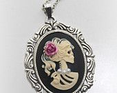 Gothic necklace:  skeleton cameo, silver pendant on black ribbon - victorian necklace cameo necklace skeleton skull with rose in hair. $15.00, via Etsy.