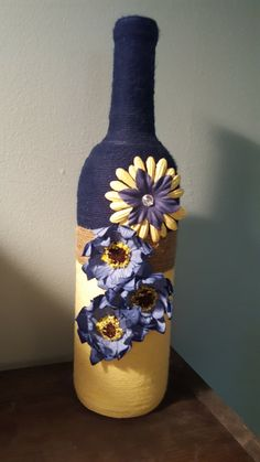Items similar to Twine Wrapped Bottle, Navy Blue and Yellow wrapped Wine Bottle on Etsy Large Wine Bottle, Wine Bottle Vases, Diy Bottle, Wine Cork Crafts, Wine Bottle Crafts, Jar Crafts, Yarn Bottles, Twine Wrapped Bottles, Pink Mason Jars