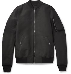 Originating as fighter pilot apparel, the bomber jacket has graduated as a mainstay in any well-dressed man's wardrobe. <a href='http://www.mrporter.com/Shop/Designers/Rick_Owens'>Rick Owens</a> gives the design a dose of its unmistakable attitude with this canvas version. Constructed in Italy and punctuated with a utility-style zipped sleeve pocket, it looks best worn with shorts and sneakers.