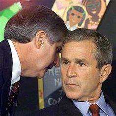"Iconic image of President Bush being informed that ""America is under attack"" which later would be known as 9/11~"