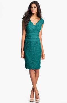 Scalloped edges enhance this flirty surplice-neck Tadashi Shoji Lace & Tulle Sheath Dress with a matte wraparound waistband. Delicate allover lace texturizes the clean-lined silhouette for added dimension. Sizes 2-16, regular and petite. $298. Free shipping.