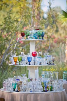 this would be a great idea....but we'd probably have too many people to do it :/  --- collection of antique mugs, glasses, and goblets...to be used during wedding reception, and to be taken home as favors by the guests. awesome.
