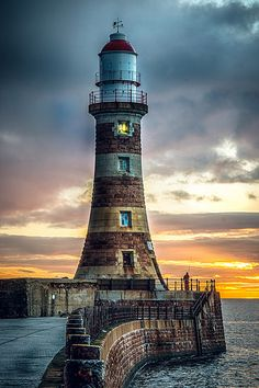 Roker Pier Lighthouse was built in 1903 on the North Pier of Sunderland Harbour. Lighthouse Pictures, Lighthouse Art, Minecraft Lighthouse, Beautiful Places, Beautiful Pictures, Beacon Of Light, Water Tower, Belle Photo, Scenery