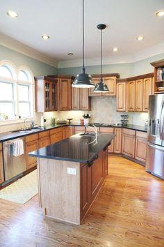 Updated kitchen with new white island, original honey oak cabinets on
