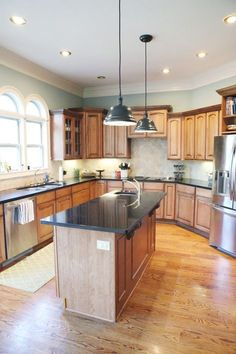 Kitchen Paint Color - this looks good with wood cabinets and floor..? but I dont have all that white trim & 5 Top Wall Colors For Kitchens With Oak Cabinets