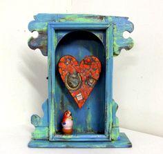 Cuckoo Orange Heart Assemblage in turquoise green cabinet https://www.etsy.com/listing/162290022/orange-heart-assemblage-in-turquoise