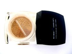 Tan Foundation   Exquisitely designed to suit your skin, the Sheer Design Tan foundation is a perfect medium tan tone. This Tan foundation is lightly garnished with a hint of Mica, a natural mineral to create a warm glow on your youthful skin. You'll be delighted with your natural look. Made with a built in sieve to help save all of your powder in the jar!  www.sheerdesign.org  www.facebook.com/sheerdesignbeauty