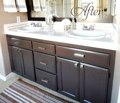 beautiful bathroom vanity with dark cabinets, silver accents... Easy Bathroom Updates for a More Luxurious Rental Apartment