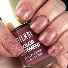 Glittery flowers. I did a base of Milani Pink Beige stamped with Milani Mauving…