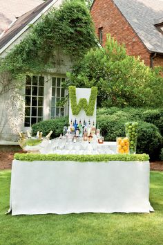 Cocktail Bar - Signature Wedding Drinks - Southernliving. Everyone seems to gather around the bar, so give it a double shot of eye-catching style. Create your own giant floral monogram from a large sheet of plastic foam and button mums. You can also frame your bar table with a border of flowers by using a garland foam and filling it with cushion mums.