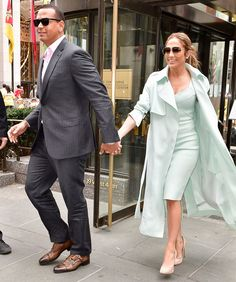 For a Big Apple lunch date, Lopez donned a mint green dress and matching trench coat that she styled with oversize sunnies, diamond stud earrings, and towering nude pumps. Meanwhile, Rodriguez wore a gray pinstripe suit, light pink collared shirt, black sunglasses, and leather kicks. from InStyle.com