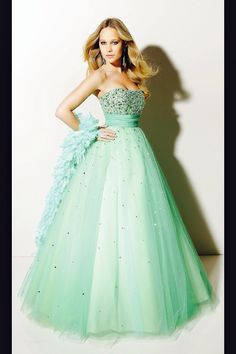 cute mint green prom dress flows at the bottom