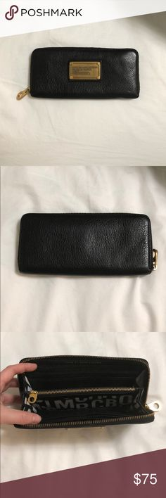 Marc by Marc Jacobs long zip wallet This is an authentic Marc by Marc Jacobs Classic Q wallet used gently and in good condition. There are no visible flaws on the outside. On the inside, there is a marking on the coin fabric (see 3rd picture). Marc By Marc Jacobs Bags Wallets