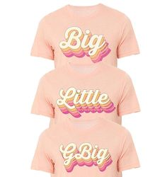 Big, Little, or GBig Retro Font Shirts on Heather Peach Tee, Multi Color Big Little Sorority Shirts These babes are super cute for big/little reveal and ship quickly! We recommend ordering the size you normally wear. Big Little Sorority Shirts, Big Little Shirts, Big Little Week, Big Little Reveal, Big Little Canvas, Big Little Basket, Little Peach, Retro Font, Sorority Gifts