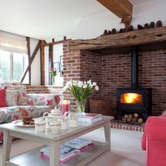 woodburning stove in a brick clad nook ....like it
