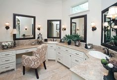 The master bathroom is a stunner in muted colors. Light Emperador marble countertops mix with light walnut travertine floors