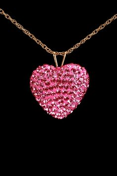 Pink diamond heart necklace.