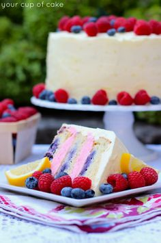 Easy Lemon Berry Cake~T~ A lovely summer cake. Starts with a white cake mix to which you add lemon juice and zest, yogurt, buttermilk, blueberries, eggs and melted butter, then frosted with a raspberry buttercream between the layers and a lemon buttercream on the outside of the cake.