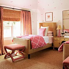 Raffia upholstery gives the bed frame a neat and polished look, while soft pinks and full-throttled magenta play off the island's tropical colors.