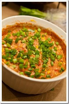 Hot Fiesta Dip (corn, scallions, refried beans, salsa, cheese) - Perfect way to use up leftover refried beans if you're like me and only use them once in a blue moon, but could love on snacky foods and dips.  :)