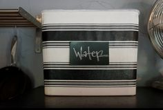 Great idea: Modge Podge fabric onto plastic bins to beautify your storage.