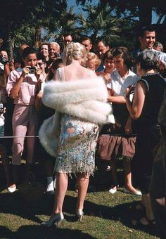 """cynema: """"Marilyn Monroe signing autographs on the set of """"Some Like It Hot"""" (1959) Photograph by Richard Miller. """""""