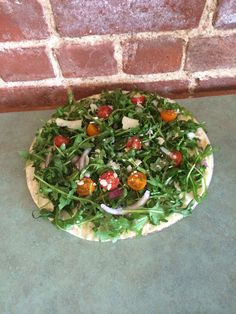 Arugula, red onions, red and yellow pear tomatoes, shaved Parmesan cheese on a crispy flat bread. Seasonal Greens