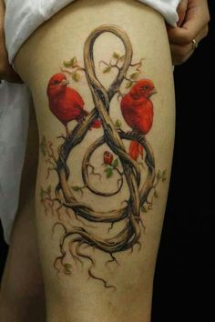 Very cool, unusual tattoo. The birds are pretty, but the brown twigs are very cool