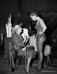 Mitzi Gaynor chats with her mother, Pauline Gerber, during a visit to the Hollywood set of Anything Goes on July 25, 1955.
