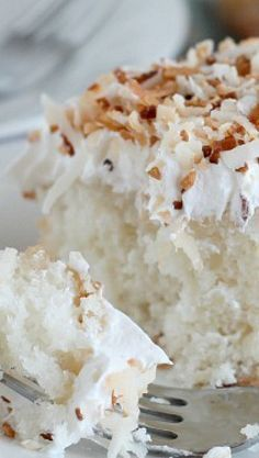 Coconut Cream Poke Cake Recipe ~ It's light, yet moist and oh so coconut-y.
