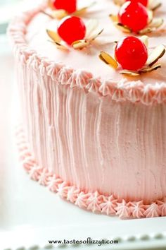 """Light, airy from-scratch maraschino cherry cakes with pink almond and cherry flavored buttercream. Top this cherry almond cake with simple little """"flowers"""" made from almonds and cherries. #cherry #mothersday #cake #almond"""