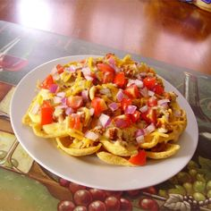 "Sloppy Jo-Chos | ""These were soooo awesomely delicious! I made my own cheese sauce and just for some extra color and goodness, I added a little shredded cheddar, and chopped red onion and tomatoes. """