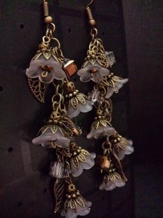 Frosted lucite flower with bronze chain and accents square
