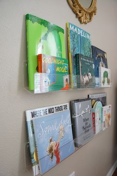 """perspex on the wall book shelf? What a great space saver! 24""""    http://cleardisplays.com/wall-display/wall-mount-literature-racks/card-shelves-with-holes-for-hanging/"""