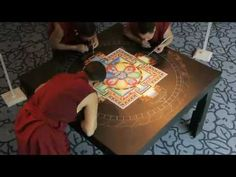 Creation of a sand mandala by Buddhist monks. This is incredible and gorgeous--the added symbolism of the act is sublime.