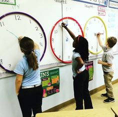 ⏰Race the Clock⏰ This was a fun activity for my kiddos. I would shout out a time and whoever illustrated it correctly gained a point for their team. We used ⭕hula hoops⭕ to portray the clock outline. 2nd Grade Classroom, Math Classroom, Kindergarten Math, Future Classroom, Classroom Displays Ks1, Year 3 Classroom Ideas, Primary School Displays, Classroom Job Chart, Classroom Tree