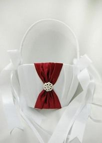 "The Splendor Collection Flower Girl Basket features rouched satin in exclusive David's Bridal colors and is adorned with a jeweled flower cluster. Available in white or ivory. Measures 10"" by 5.0"". Weighs 8 ounces. Click here for Splendor colors on sale Please Note: Select Colors available in stores."