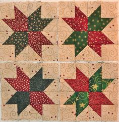 Star Studded blocks in classic Christmas fabric Deck-ade the Halls  by Quilter Kathy via Flickr