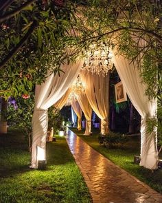 Wow! Loving this walkway with accent #uplighting  #draping! Nice photo via #Decozilla #cocoonevents