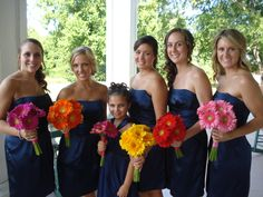 different colors of gerber daisies for each bridesmaid for this wedding at Carnton Plantation, Franklin, Tennessee