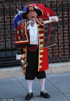 A town crier announces the birth of the son of The Duke and Duchess of Cambridge outside the Lindo Wing at St Mary's Hospital