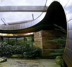 A Hobbit House In The Trees.   Wilkinson Residence Portland , Oregon Designed: 1997 Completed: 2004 Located on a flag lot, a steep sloping grade provided the opportunity to bring the main level of the house into the tree canopy to evoke the feeling of being in a tree house.