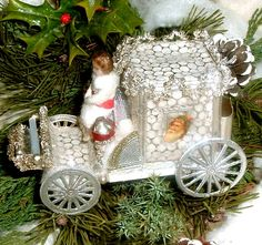 Sebnitz Carriage with Wax Baby, Santa sctap, glass beads,Dresden trims. By Betsy Browning. browning..designwerks@gmail.com