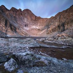 """@spaethasaurus and I started hiking at 3:30am in order to reach Chasm Lake by sunrise. Besides the headlamps of climbers slowly ascending Longs Peak across the lake we were entirely alone, exploring the lake and taking in the scenery. These are the kinds of moments I live for! I used a 10"""" exposure and the @leefilters .9 ND grad to give more detail and movement to the clouds ✌️#letsgetadventuring"""