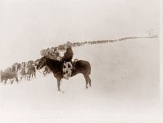 Cowboy working in a snowstorm. The picture was taken in Wyoming in 1923.