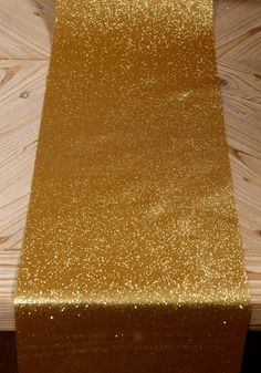 Save On Crafts website has great stuff and great prices.  This is Glitter Ribbon Runner Gold 10in x 9ft