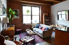How This Couple Makes Their Tiny Studio Feel So Much Bigger  #refinery29  http://www.refinery29.com/brooklyn-studio-apartment-home-tour#slide-6  Another view of the apartment's living space. ...